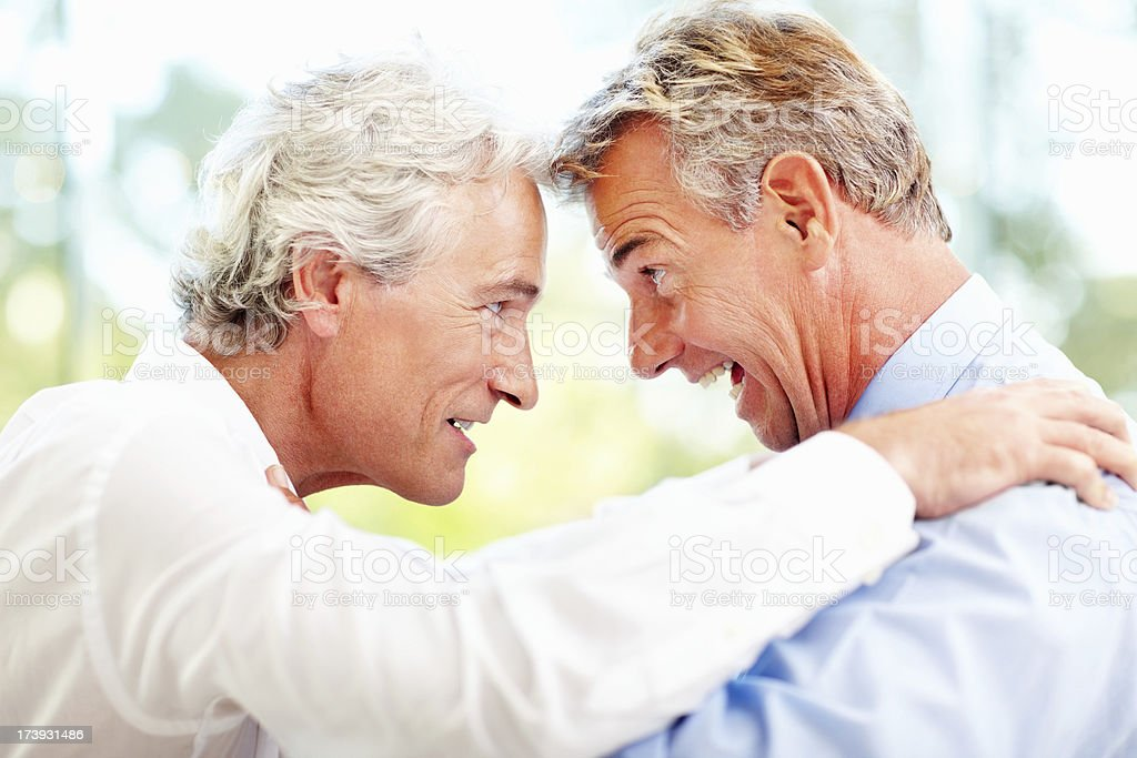 Excited business colleagues looking at each other royalty-free stock photo