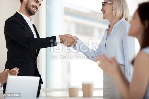 istock Excited business partners handshake after successful meeting 1070375360