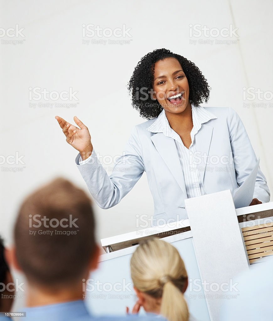 Excited business woman addressing a group of people royalty-free stock photo