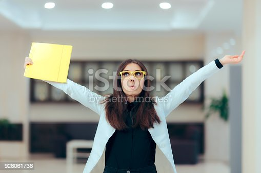 istock Excited Business Women Holding Up Important Documents 926061736