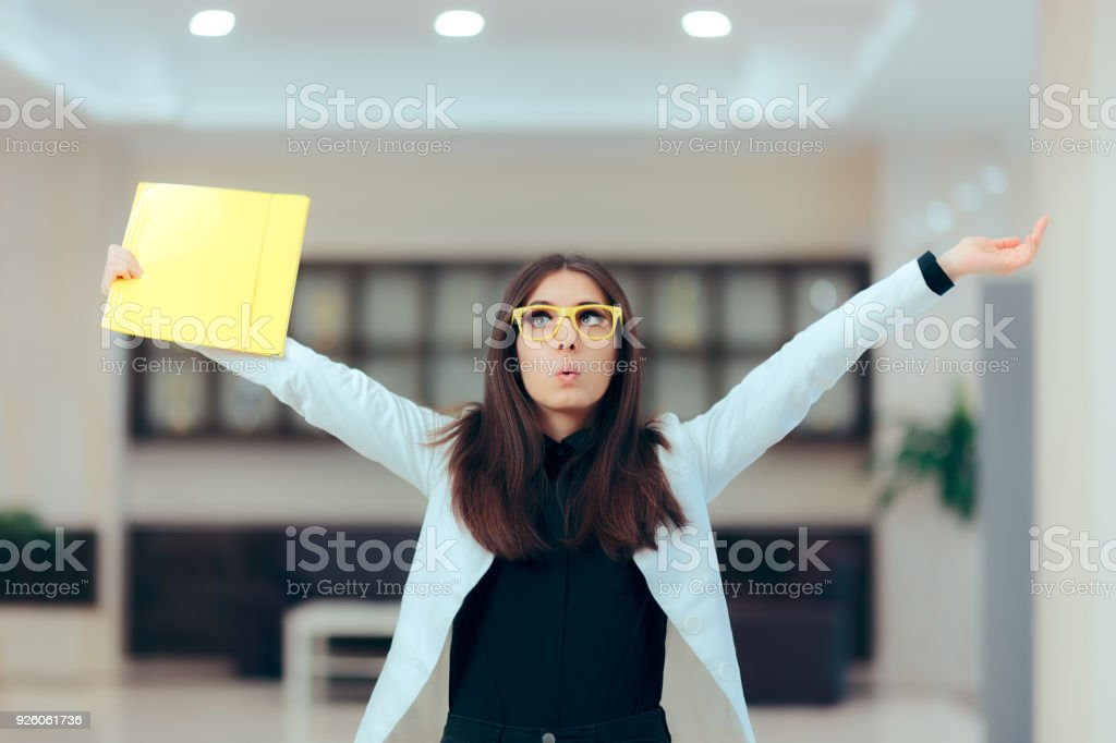 Excited Business Women Holding Up Important Documents stock photo