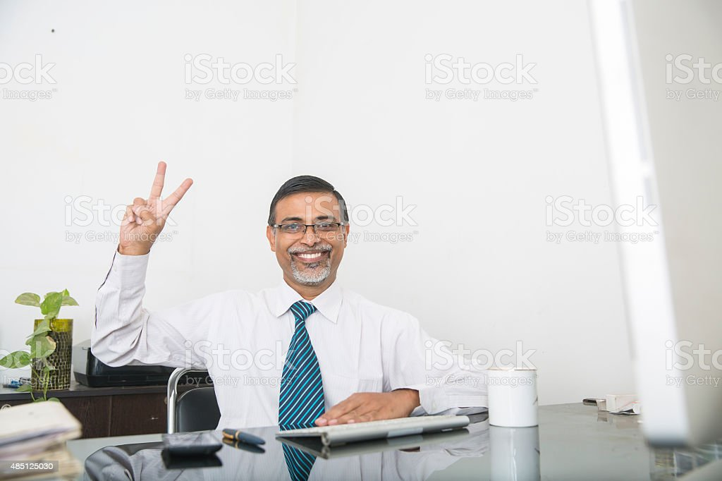 Excited Businessman Giving the Thumbs Up stock photo