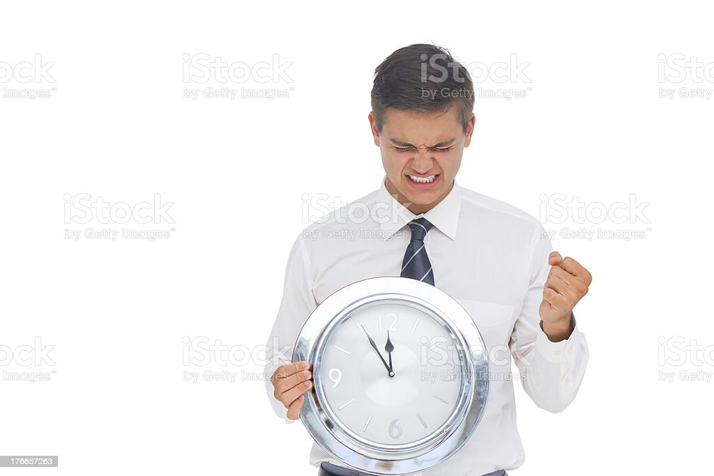 Excited businessman holding a clock royalty-free stock photo