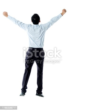 Excited businessman jumping and cheering on white background.