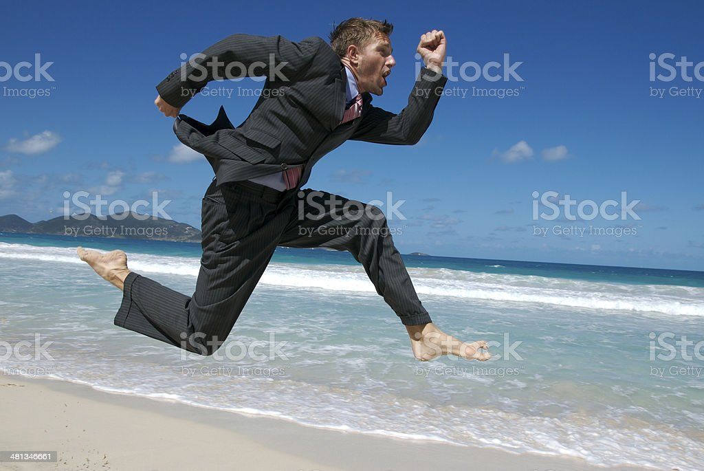 Excited Businessman Jumping Barefoot Above Tropical Waves royalty-free stock photo
