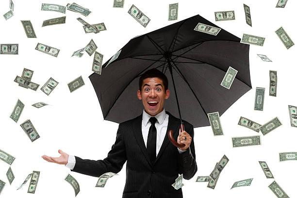 aufgeregt geschäftsmann raining geld - sterntaler stock-fotos und bilder