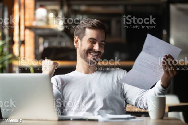 Excited businessman reading postal mail letter overjoyed by great picture id1199696917?b=1&k=6&m=1199696917&s=612x612&h=1zrd5eefn6lm9kqkhmoxdmtp2ohu4tmcz4kxgibpxok=