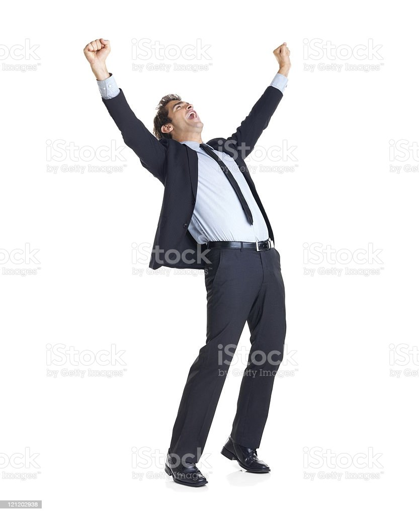 Excited businessman with arms raised in success royalty-free stock photo