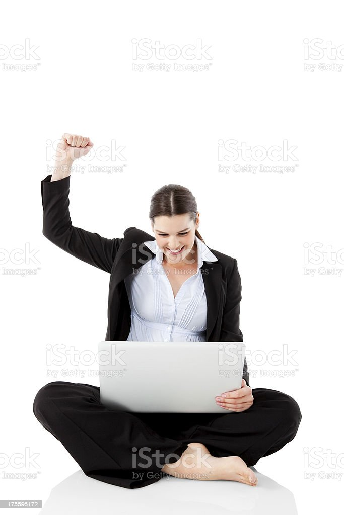 Excited businesswoman celebrating success with laptop royalty-free stock photo