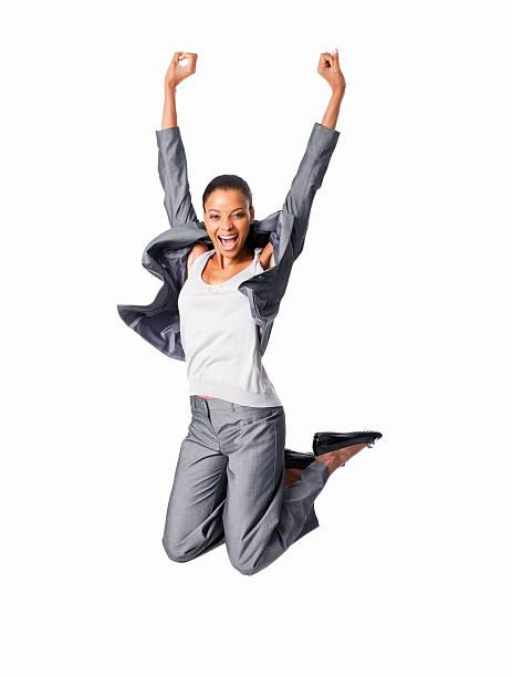 Feliz Mulher de negócios saltando-isolado - foto de acervo