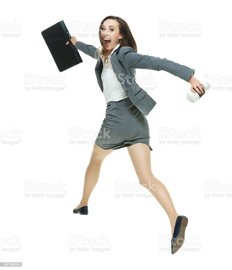 Excited businesswoman running stock photo