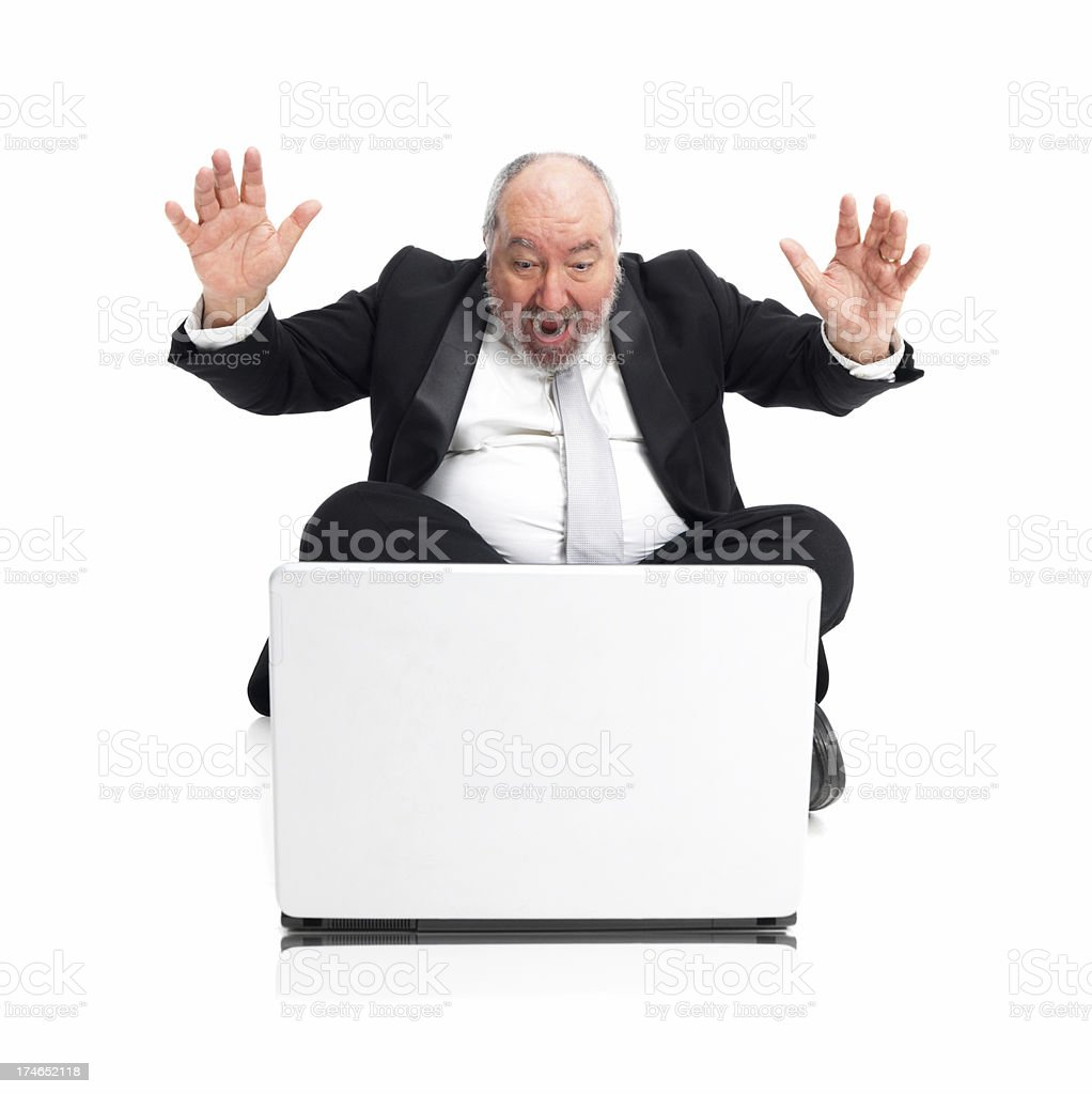 Excited bussinessman using laptop royalty-free stock photo