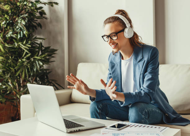 excited busy woman talking with colleague in video chat - remote work imagens e fotografias de stock