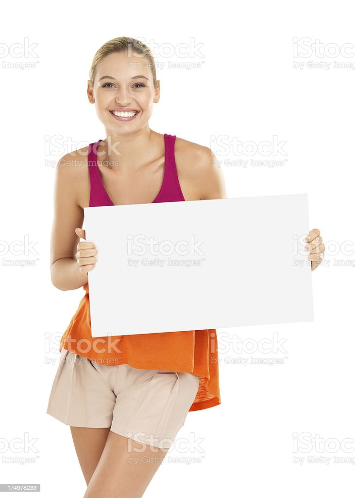 Excited by your awesome product! - Copyspace A pretty young woman holding a blank placard while isolated on a white background Adult Stock Photo