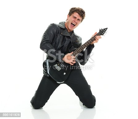 istock Excited casual man playing guitar 595161926