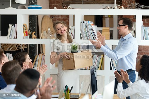 924520144 istock photo Excited CEO and workers applaud welcoming newcomer to team 1071915638