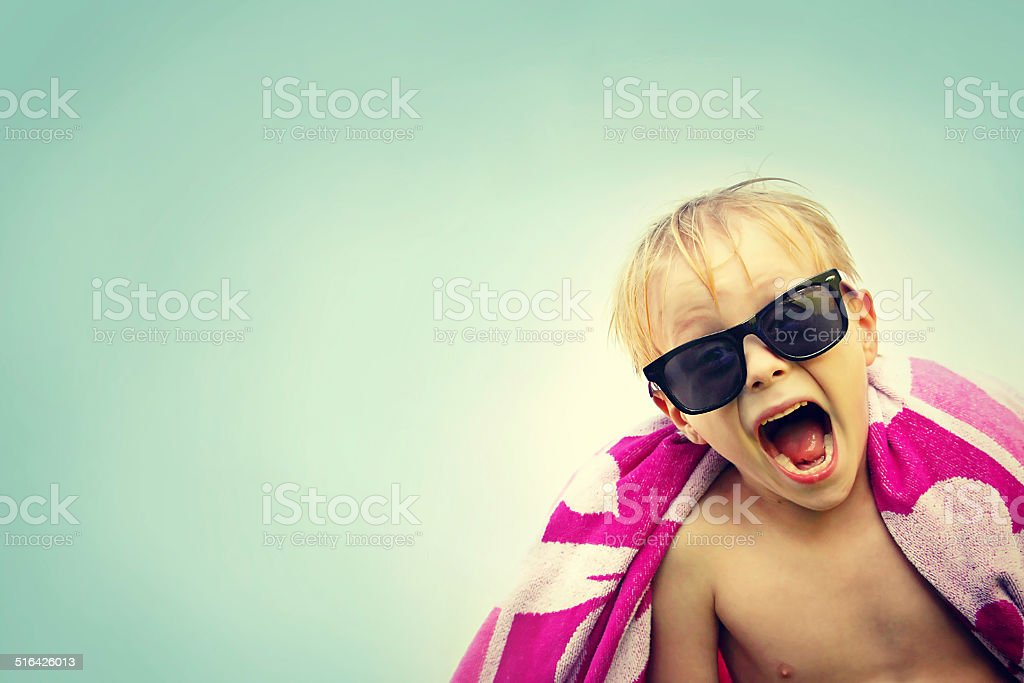 Excited Child in Beach Towel on Summer Day stock photo