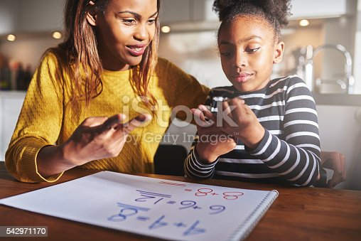istock Excited child learning to calculate 542971170