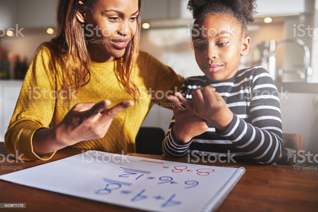 Excited child learning to calculate stock photo