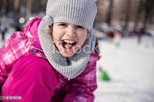 istock Excited child playing in the snow 1187876105