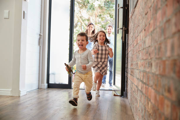 Excited Children Arriving Home With Parents Excited Children Arriving Home With Parents front door stock pictures, royalty-free photos & images