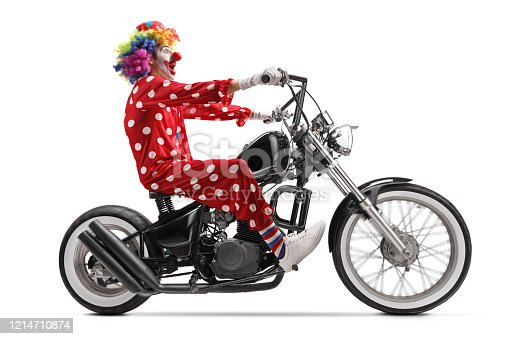 istock Excited clown riding a chopper motorbike 1214710874