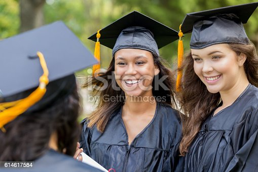 istock Excited college friends after graduation 614617584
