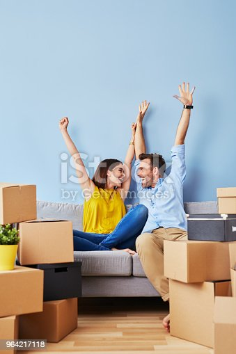 istock Excited couple moving to new apartment 964217118