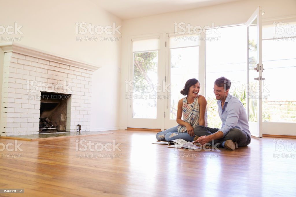 Excited Couple Planning Decoration Of New Home stock photo