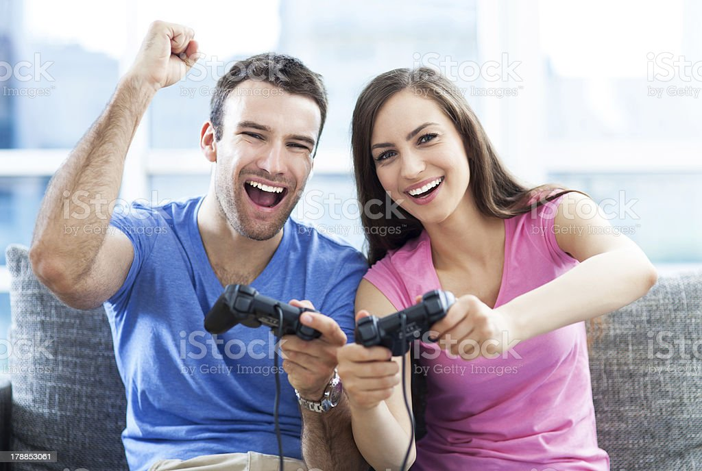 Excited couple playing video games royalty-free stock photo