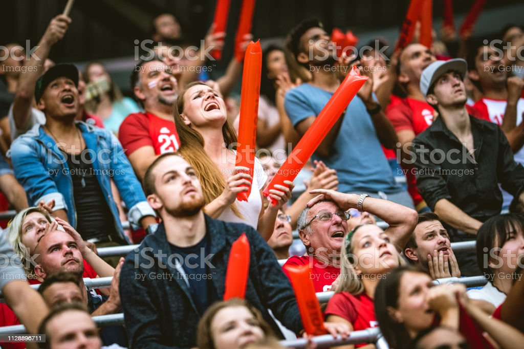 Excited crowd on a stadium very active cheering their football club...