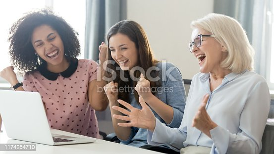 istock Excited diverse female employees feel euphoric winning online 1174254710