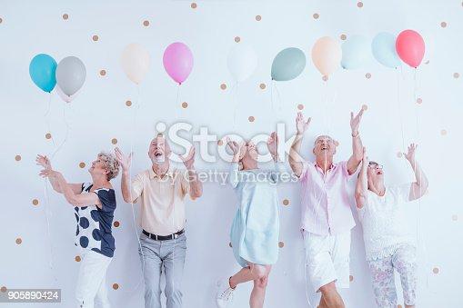 istock Excited elderly men and women 905890424