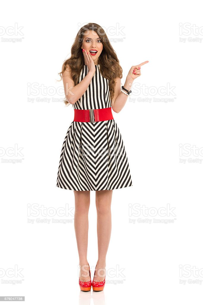 Excited Elegant Woman Pointing stock photo