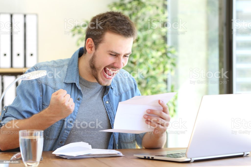 Excited entrepreneur reading a letter - Photo