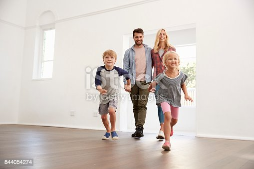 istock Excited Family Explore New Home On Moving Day 844054274