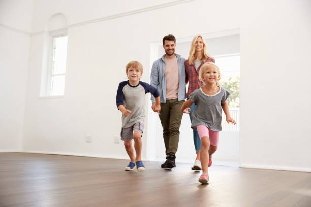 excited family explore new home on moving day - house hunting stock photos and pictures