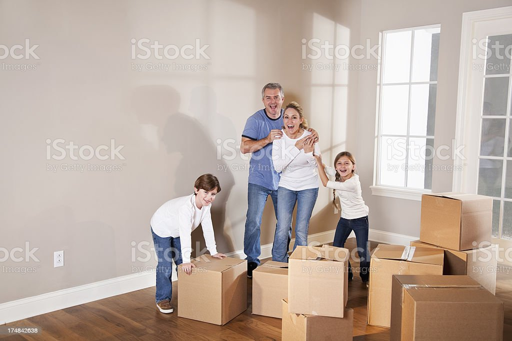 Excited family moving into new home stock photo
