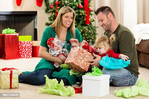 579124316 istock photo Excited family on Christmas morning 584249442