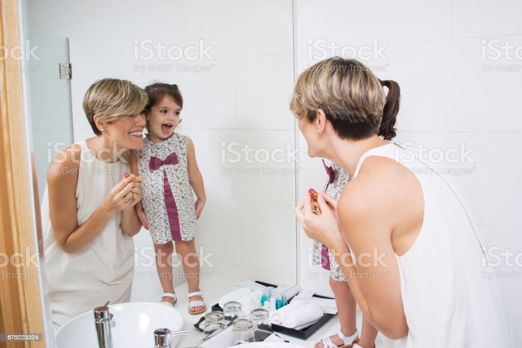 Excited family putting makeup on royalty-free stock photo