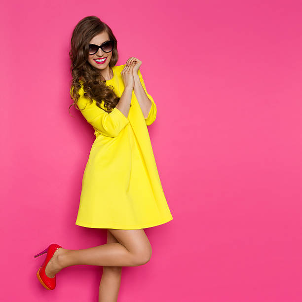 excited fashion girl - mini dress stock photos and pictures