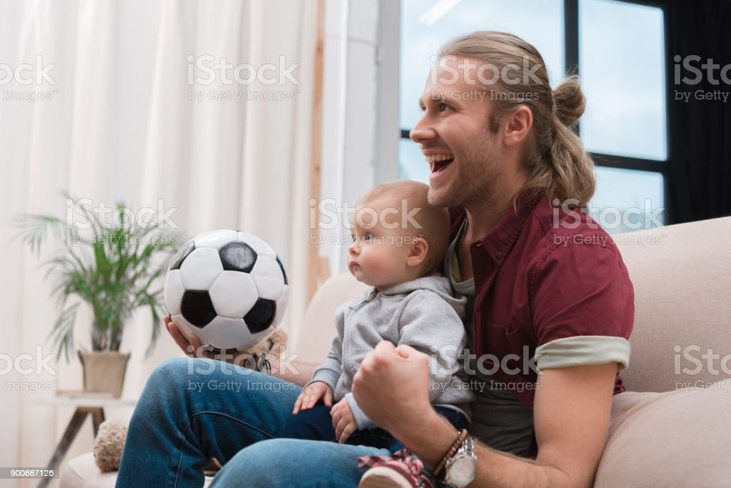 excited father with baby boy stock photo