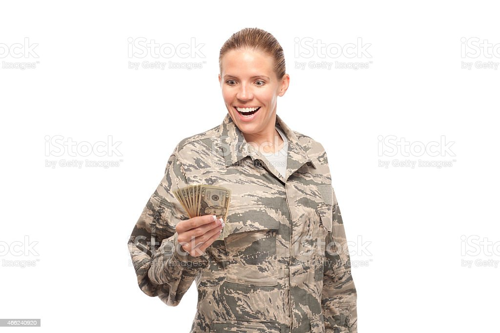 Excited female airman with money stock photo