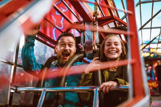 Excited female and scared male on a rollercoaster ride in theme park picture id1172976370?b=1&k=6&m=1172976370&s=612x612&w=0&h=qjdo4bk 69o0jxguzifcbevjlsiunq syvaixura2ko=
