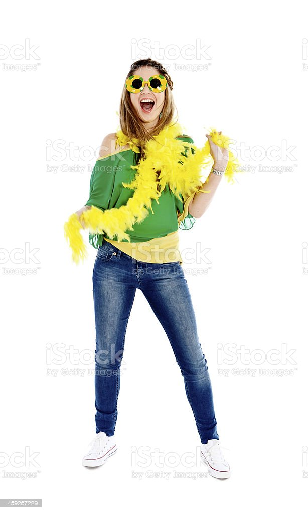 Excited female fan in Brazilian soccer team colors stock photo