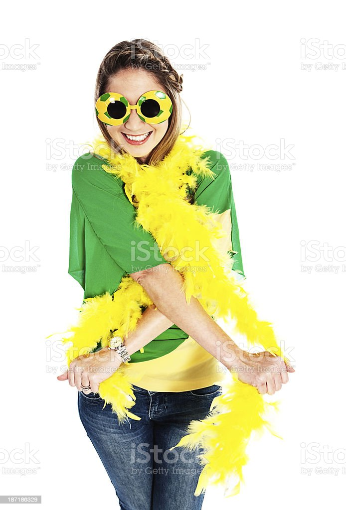 Excited female fan supports Brazilian team royalty-free stock photo