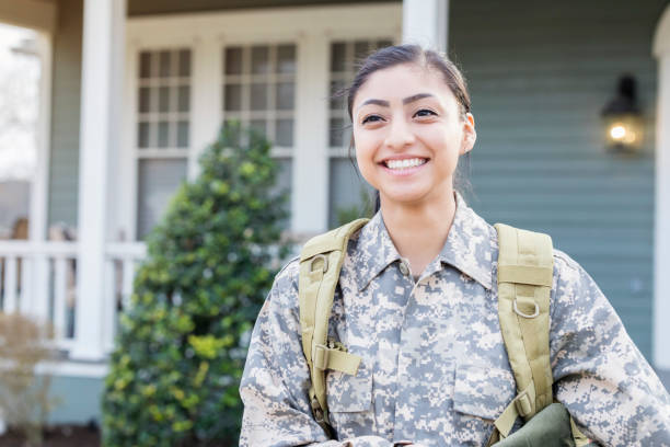 excited female soldier leaving for deployment - armed forces stock photos and pictures