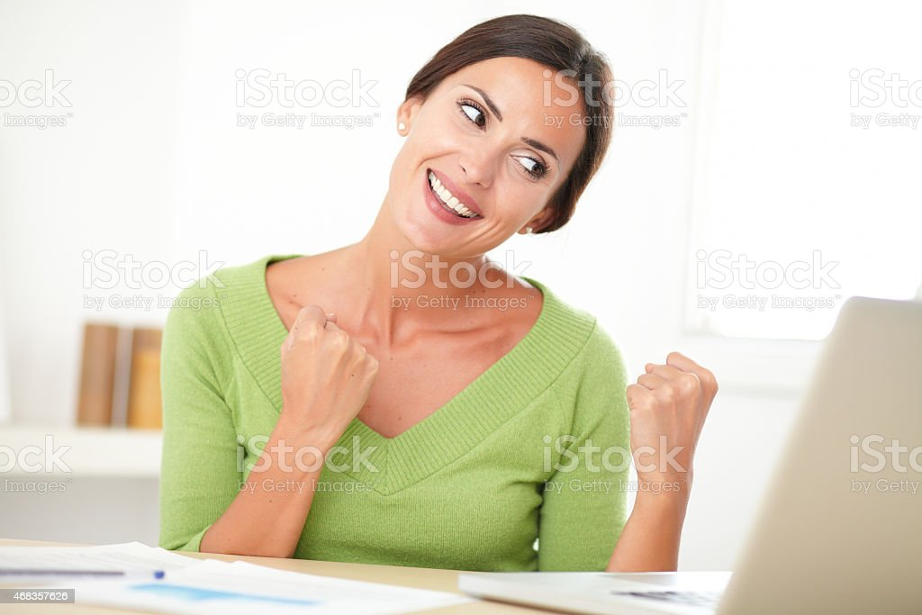 Excited female winner browsing the web royalty-free stock photo