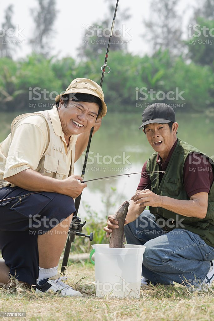 Excited fishermen royalty-free stock photo