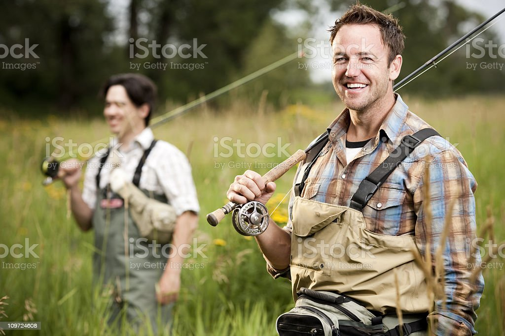 Excited Fly Fisherman with Fishing Buddy royalty-free stock photo